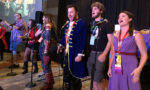 Singers performing songs from The Greatest Showman